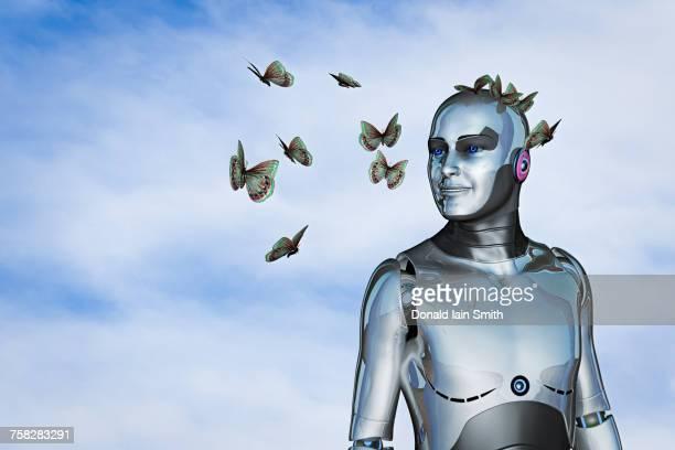 Smiling robot watching butterflies