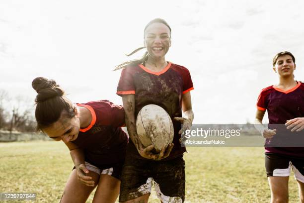 smiling rugby players on the rugby field - rugby stock pictures, royalty-free photos & images