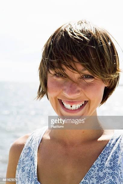 A smiling Scandinavian woman in the archipelago Sweden.