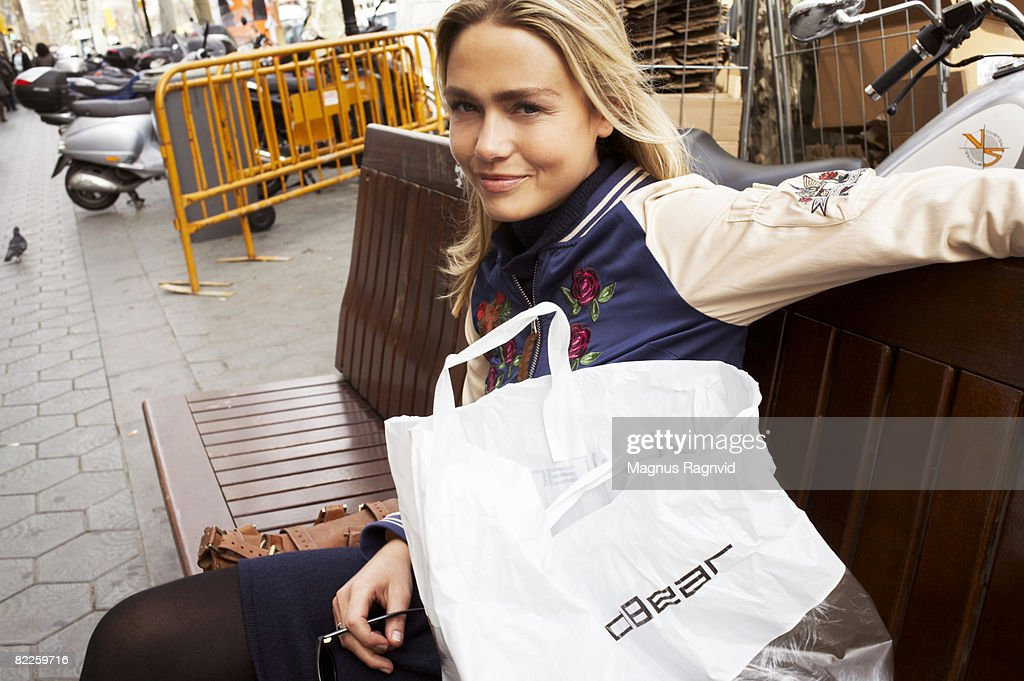 A smiling Scandinavian woman with plastic bags. : Stock Photo