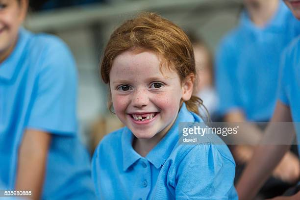 Smiling School Girl In Uniform Missing Teeth