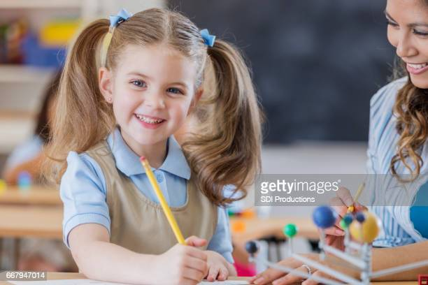 smiling schoolgirl in science class - space and astronomy stock pictures, royalty-free photos & images