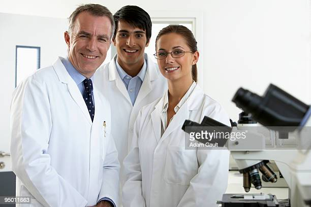 Smiling scientists in laboratory