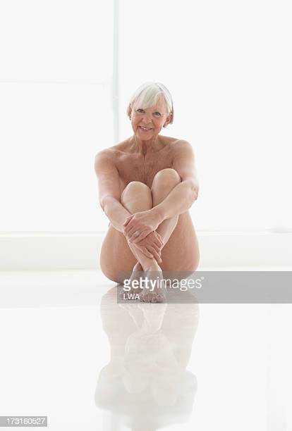 Smiling seated mature woman