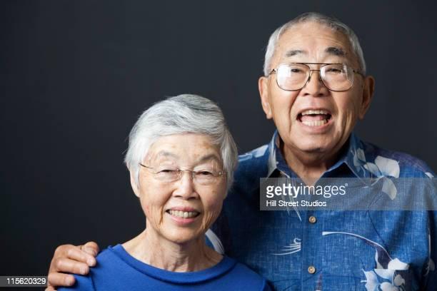 Smiling senior Asian couple