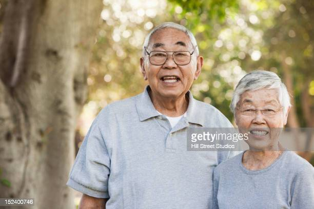Smiling senior Asian couple