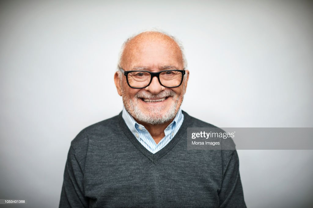 Smiling senior businessman on white background : Stock Photo