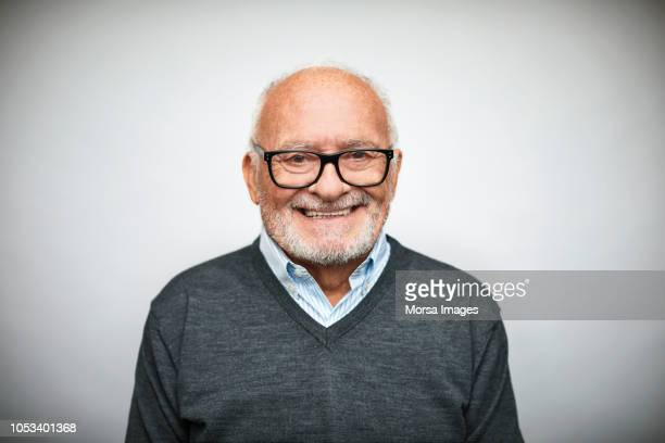 smiling senior businessman on white background - senior stock-fotos und bilder
