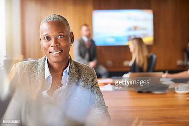 smiling senior businesswoman and her team - managing director stock pictures, royalty-free photos & images