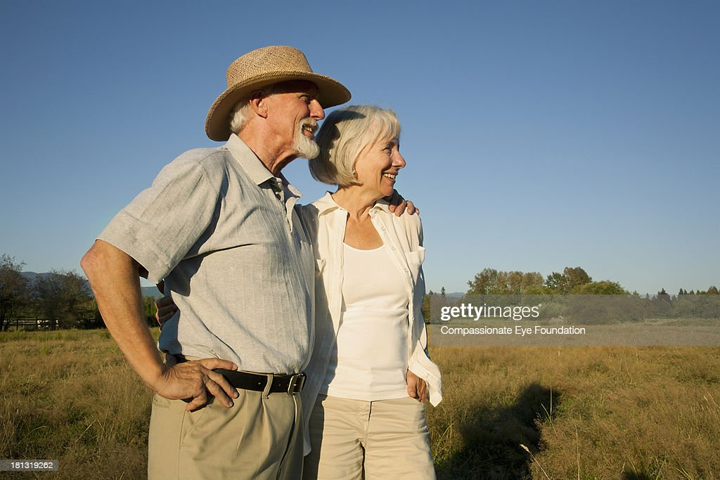 Smiling senior couple in countryside : Stock Photo