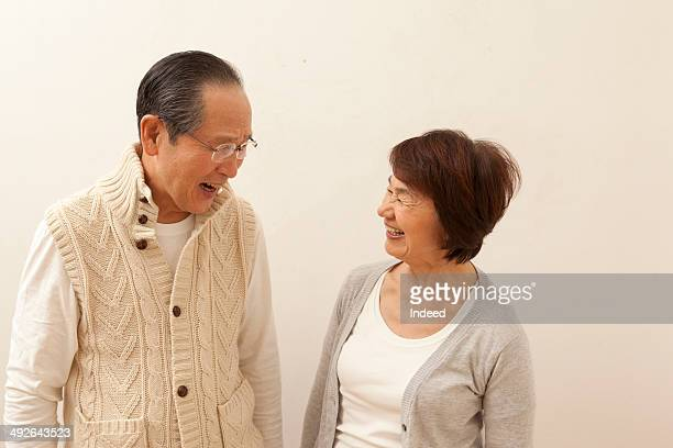 Smiling senior couple looking face to face