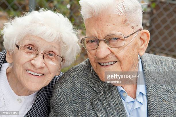 smiling senior couple - copd stock photos and pictures