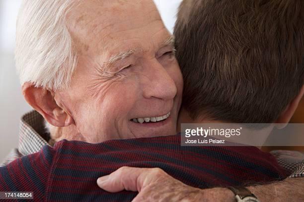 Smiling Senior dad Hugging His son