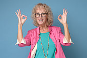 smiling senior lady glasses gesturing perfect
