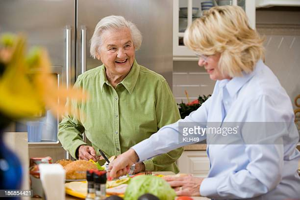 Smiling Senior Lady with a friend in a kitchen