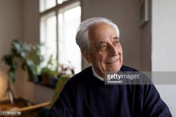 smiling senior man at home - senior men stock pictures, royalty-free photos & images