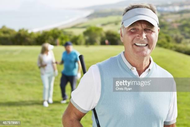 Smiling senior man on golf course