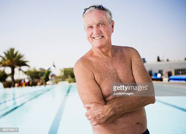 smiling senior man swimmer at pool - waist up stock pictures, royalty-free photos & images