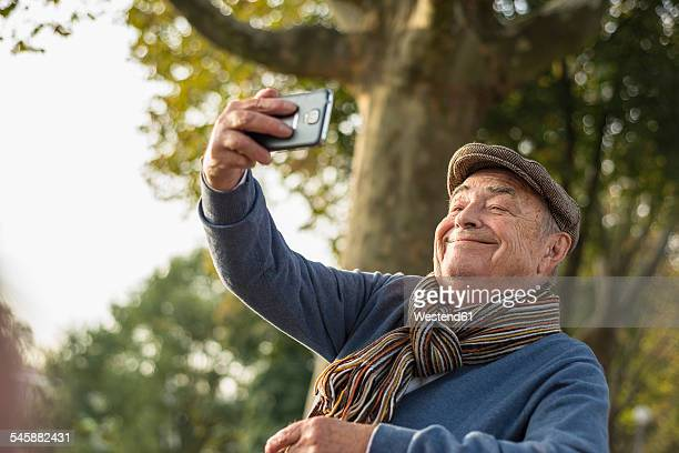 Smiling senior man taking a selfie