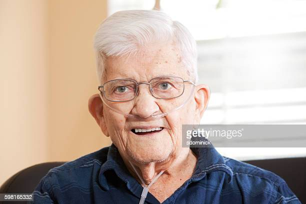 smiling senior man wearing oxygen - copd stock photos and pictures