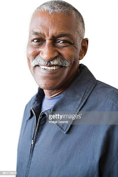 Smiling senior man with a mustache