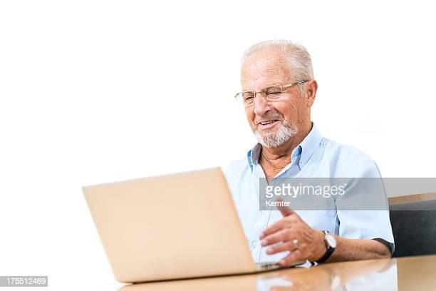 smiling senior man working with laptop