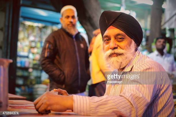 smiling senior sikh man in new delhi at evening - sikh stock pictures, royalty-free photos & images