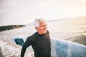 Smiling senior surfer