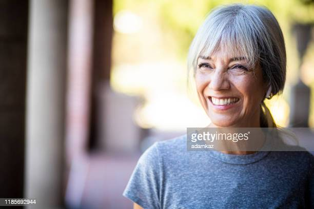 smiling senior woman during workout - mature women stock pictures, royalty-free photos & images