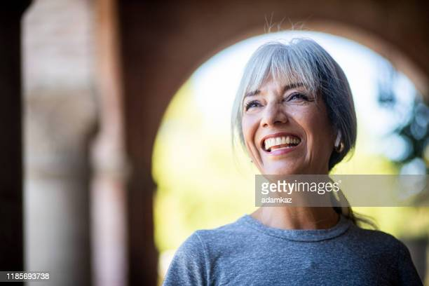 smiling senior woman during workout - active seniors stock pictures, royalty-free photos & images