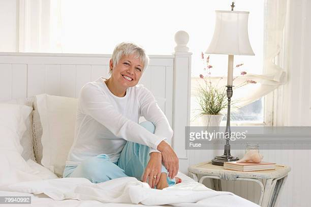 smiling senior woman in bed - white hair stock photos and pictures