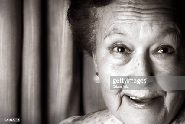 Smiling Senior Woman Looking at Camera, Black and White