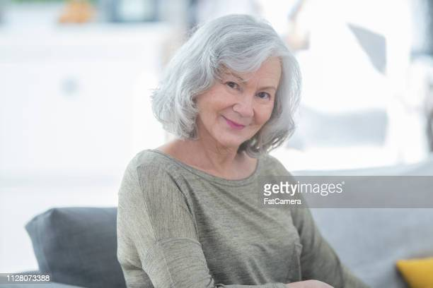 smiling senior woman - fatcamera stock pictures, royalty-free photos & images