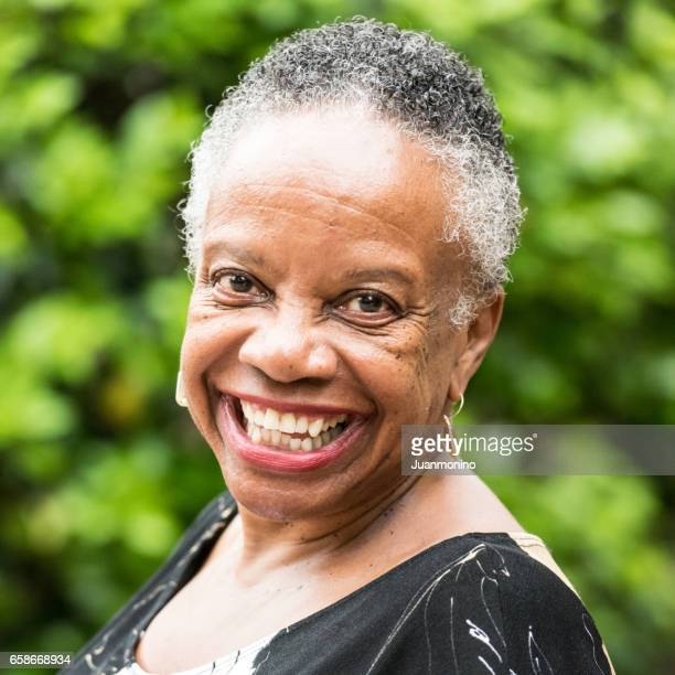 smiling senior woman - afro caribbean ethnicity stock pictures, royalty-free photos & images