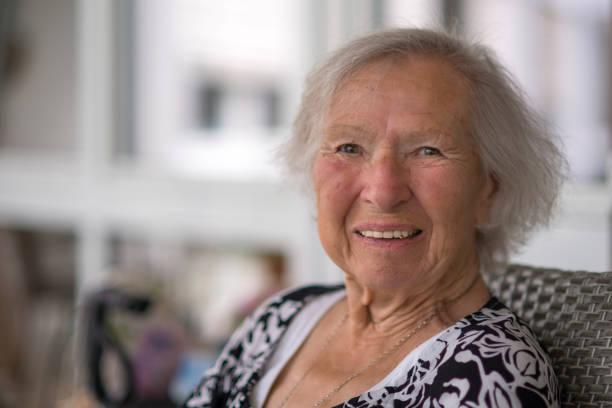 Smiling senior woman sitting on chair