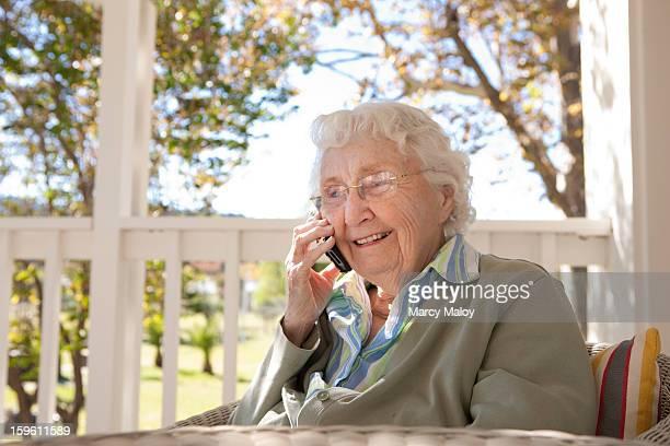 Smiling senior woman talking on a mobile phone.