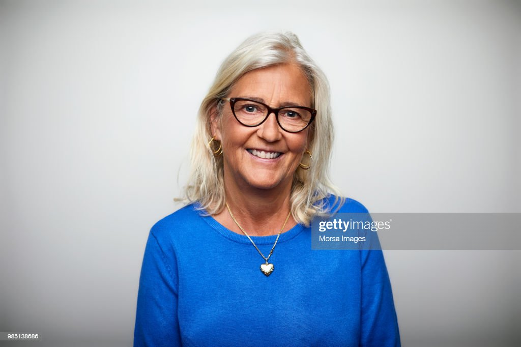Smiling senior woman wearing eyeglasses : Stock Photo