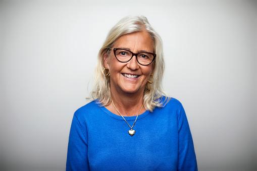 Smiling senior woman wearing eyeglasses - gettyimageskorea