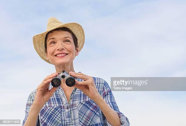 Smiling senior woman with binoculars