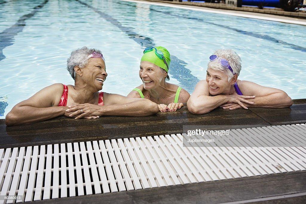 Smiling senior women in pool : Stock Photo