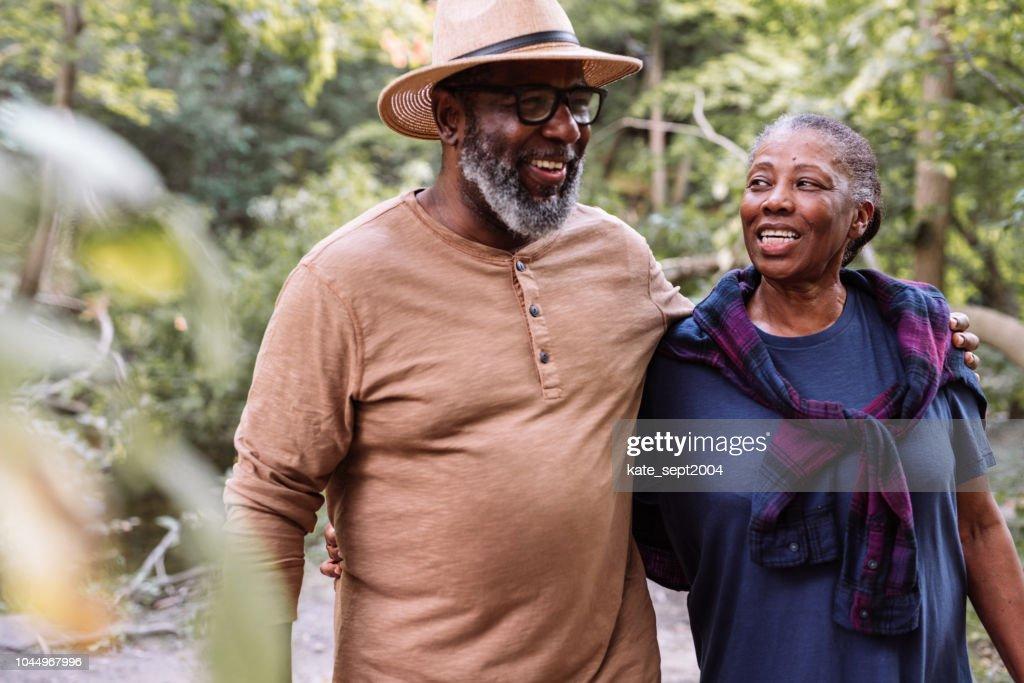 Smiling seniors couple on the walk : Stock Photo
