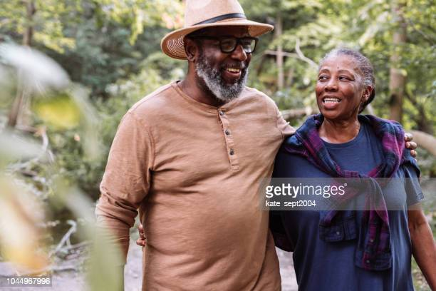 smiling seniors couple on the walk - botanical garden stock pictures, royalty-free photos & images