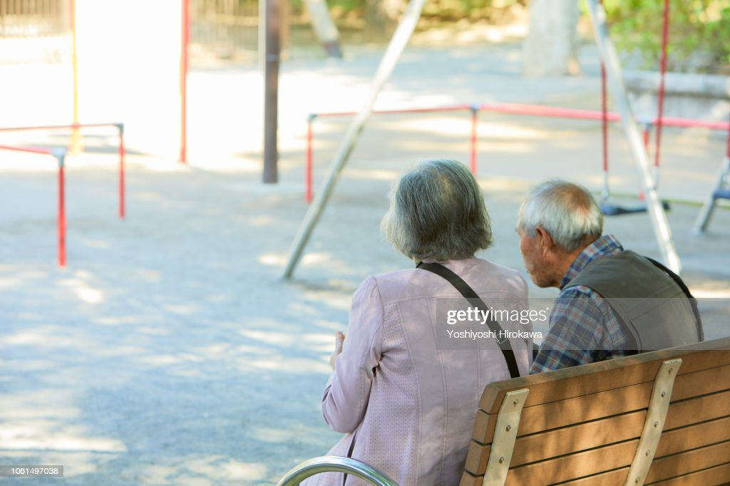 Smiling seniors who sitting on bench after walk in the park : Stock Photo