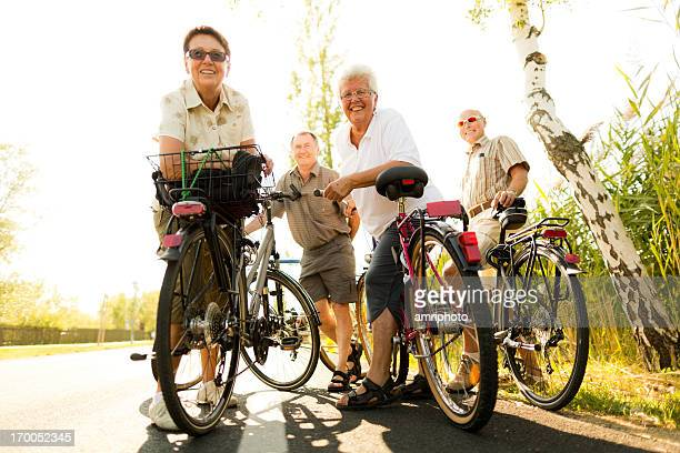 smiling seniors with bicycles