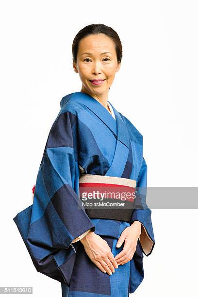Smiling serene mature Japanese woman in kimono
