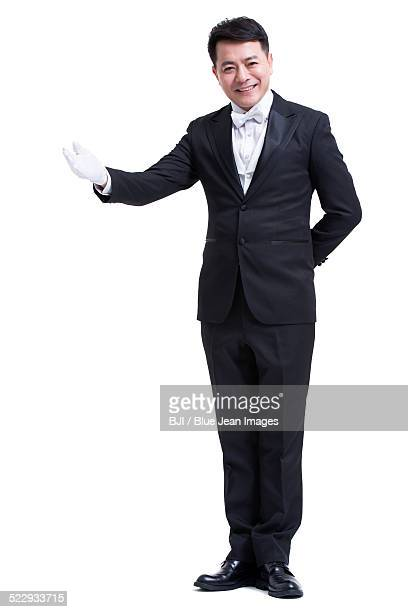 smiling service staff - formal glove stock pictures, royalty-free photos & images
