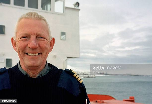 smiling ship captain - team captain stock pictures, royalty-free photos & images