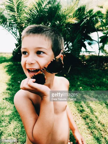 smiling shirtless boy looking away - data topuria stock pictures, royalty-free photos & images