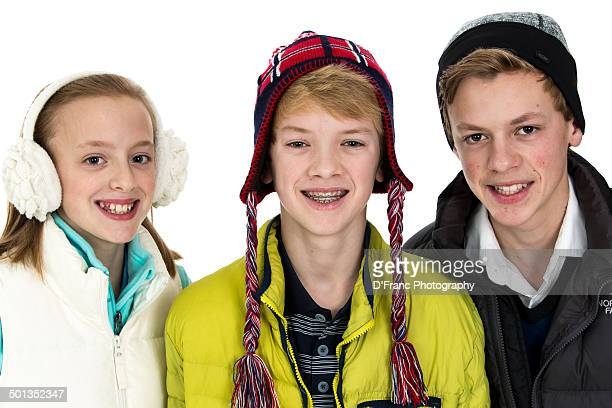 Smiling siblings ready for winter