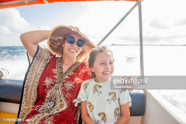 Smiling Single Mother and Daughter on a Boat Trip